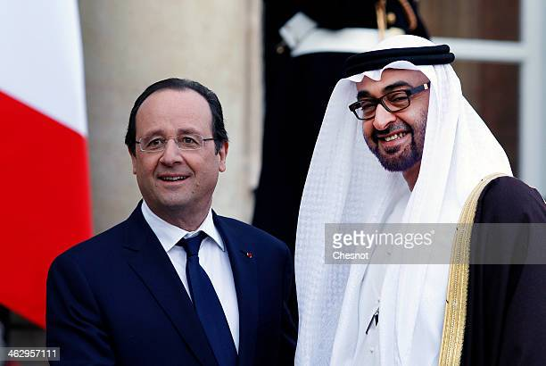 France's President Francois Hollande welcomes Emirates Foreign Minister Sheik Abdullah bin Zayed Al Nahyan for a meeting at the Elysee Palace on...