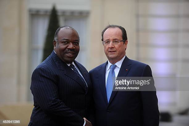 France's President Francois Hollande welcomes his Gabonese counterpart Ali Bongo Ondimba for the Peace And Safety In Africa Summit at Elysee Palace...