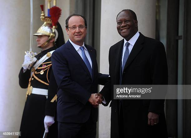 France's President Francois Hollande welcomes his Ivorian counterpart Alassane Ouattara for the Peace And Safety In Africa Summit at Elysee Palace on...