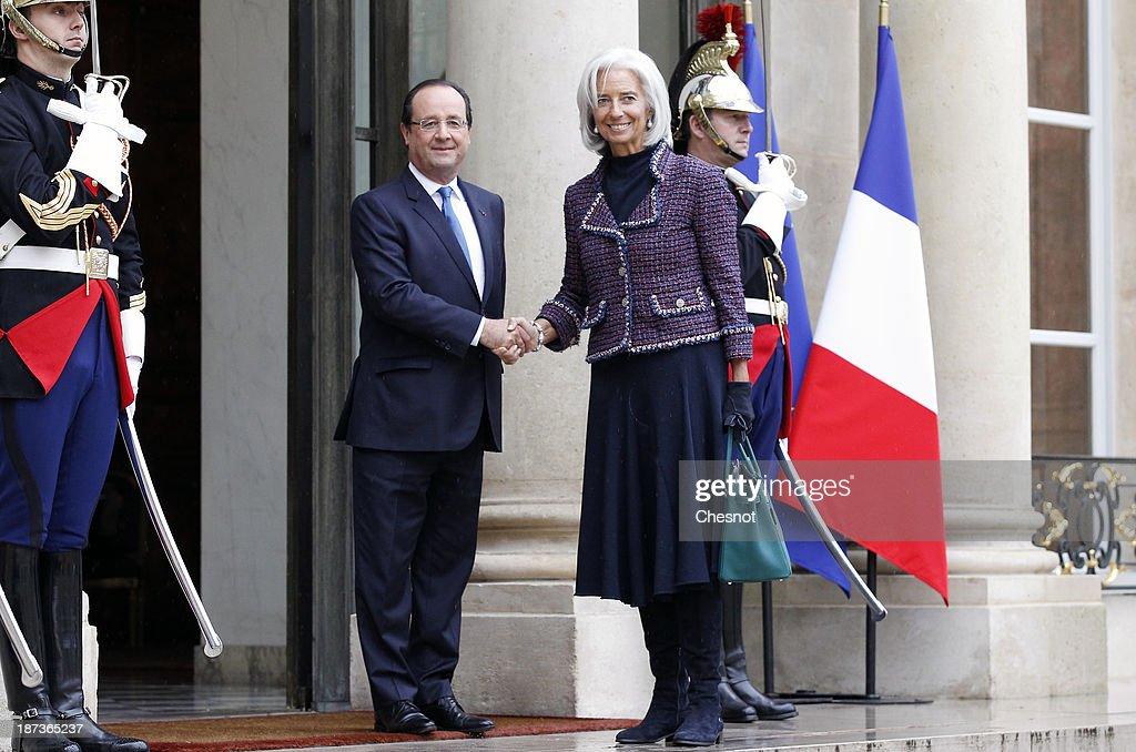 France's President Francois Hollande (L) welcomes International Monetary Fund (IMF) Managing Director Christine Lagarde prior to a meeting at the Elysee Presidential Palace on November 8, 2013 in Paris, France. The rating of France's sovereign debt has been downgraded for the second time in two years, as ratings agency Standard and Poor's cut the nation's credit rating from AA+ to AA.