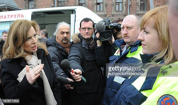 France's President Francois Hollande's companion Valerie Trierweiler speaks with Russian social workers who take care of homeless people in the...