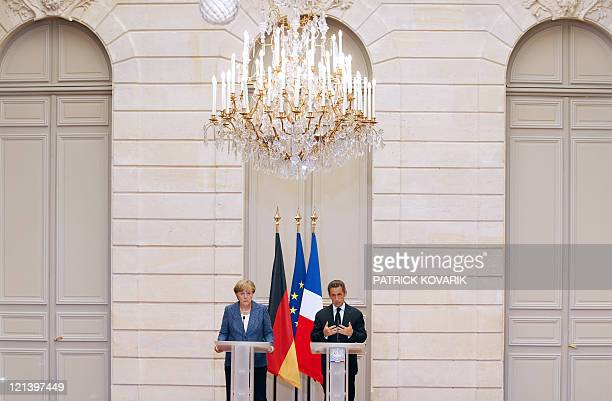 France's president Nicolas Sarkozy and German Chancellor Angela Merkel give a joint press conference at the Elysee presidential palace in Paris on...