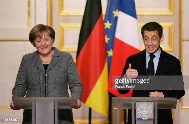 France's President Nicolas Sarkozy and German Chancellor Angela Merkel give a news conference following a FrancoGerman intergovernmental meeting at...