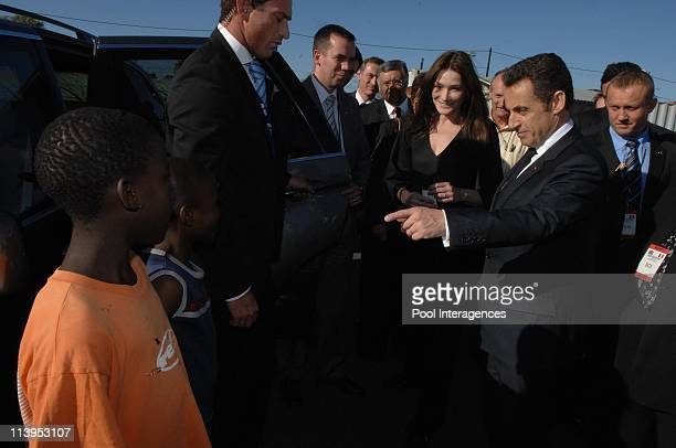 France's President Nicolas Sarkozy and his wife Carla BruniSarkozy visit the Gugulethu AIDS institute with Archbishop Desmond Tutu in Cape Town South...
