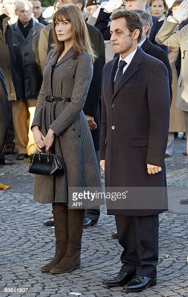 France's President Nicolas Sarkozy and his wife Carla BruniSarkozy take part in the Armistice Day wreathlaying ceremony at the statue of former Prime...