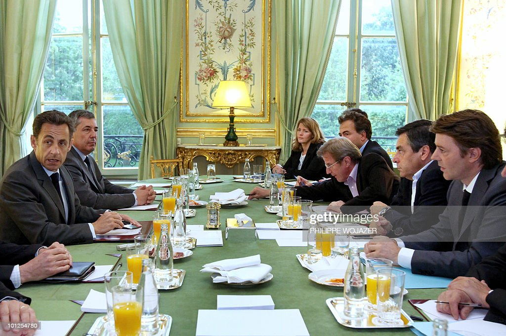 France's President Nicolas Sarkozy (L), beside his special adviser Henri Guaino (2ndL), attends a government meeting about the European financial crisis with Prime Minister Francois Fillon (2ndR), Budget Minister Francois Baroin (R) and Foreign Minister Bernard Kouchner (3rdR) at the Elysee Palace in Paris, on May 9, 2010.