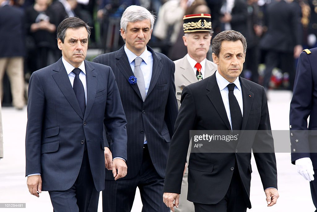 France's President Nicolas Sarkozy (R), France's Prime Minister Francois Fillon (L) and France's Defence Minister Herve Morin (C) arrives to attend a ceremony marking the 65th anniversary of the Allied victory over Nazi Germany in World War II, in Colmar, eastern France, on May 8, 2010. French General de Lattre de Tassigny led the French first Army who freed Colmar, on February 2, 1945.