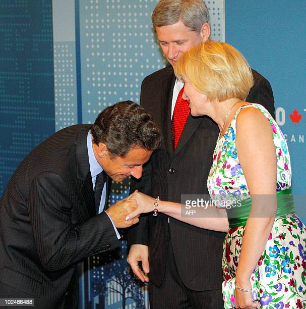 France's President Nicolas Sarkozy is welcomed by Canadian Prime minister Stephen Harper and his wife Laureen as he arrives at the G20 Summit in...