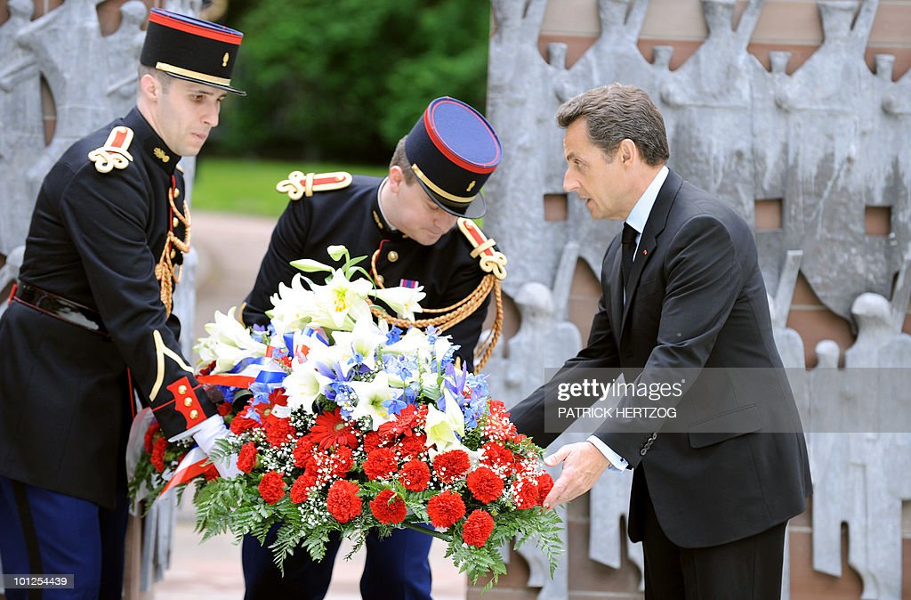 France's President Nicolas Sarkozy lays a wreath at the base of a statue honouring the first Army and French General de Lattre de Tassigny during a ceremony marking the 65th anniversary of the Allied victory over Nazi Germany in World War II, in Colmar, on May 8, 2010.