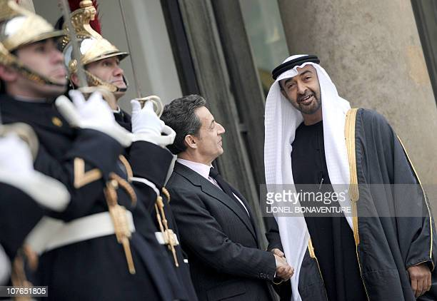 France's President Nicolas Sarkozy looks at Abu Dhabi's Crown Prince Sheikh Mohammad bin Zayed alNahayan upon arrival for a working lunch on December...