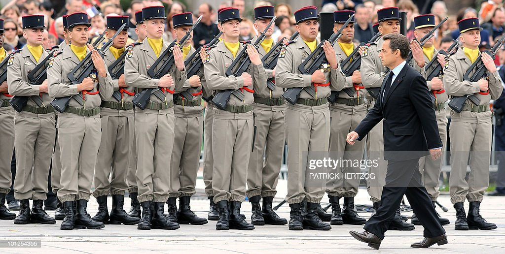 France's President Nicolas Sarkozy reviews the troops during a ceremony marking the 65th anniversary of the Allied victory over Nazi Germany in World War II, in Colmar, eastern France, on May 8, 2010. French General de Lattre de Tassigny led the French first Army who freed Colmar, on February 2, 1945.