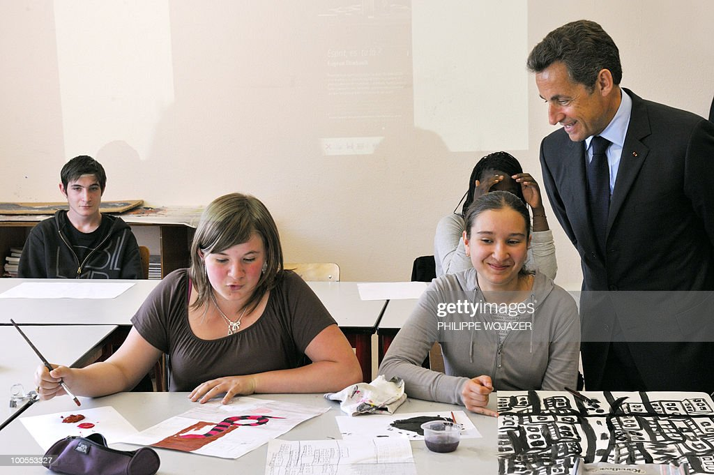 France's President Nicolas Sarkozy speaks with students during a visit at the Charles Fauqueux high school after a meeting to discuss violence in French schools, on May 25, 2010 in Beauvais, northern France. arkozy, whose popularity rating in France has slipped to record lows in recent months, expressed concern about absenteeism and violent incidents in schools, during talks with teachers and local officials.