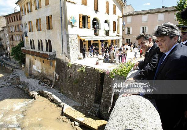 France's President Nicolas Sarkozy stands on a bridge over the Nartuby river during a visit with France's Ecology Minister JeanLouis Borloo to the...