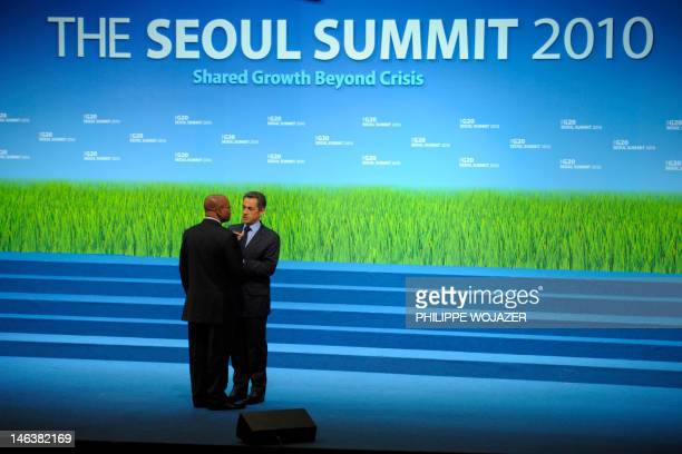 France's President Nicolas Sarkozy talks to South Africa's President Jacob Zuma following the family photo session of the G20 Summit in Seoul...