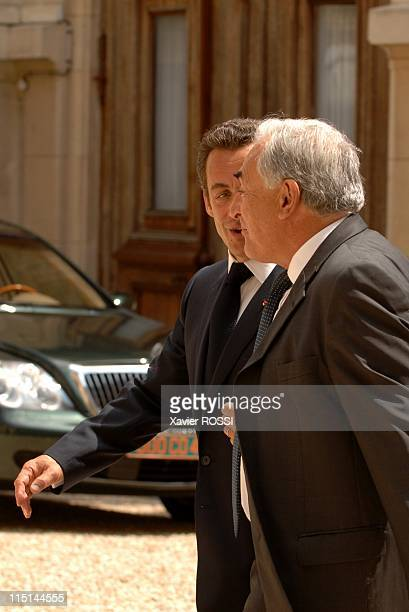 France's President Nicolas Sarkozy welcomes former Socialist Finance minister Dominique StraussKahn at the Hotel Marigny during the celebration of...