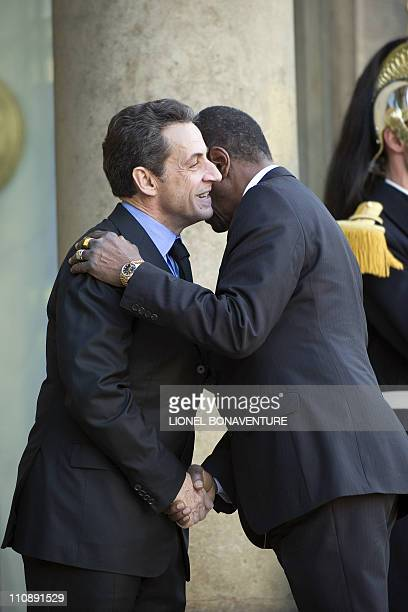 France's President Nicolas Sarkozy welcomes Guinea's President Alpha Conde before a meeting at the Elysee presidential Palace in Paris, on March 23,...