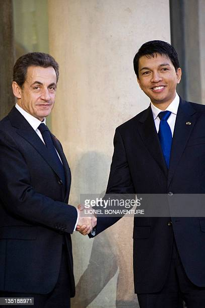 France's President Nicolas Sarkozy welcomes Madagascar's transition President Andry Rajoelina at the presidential Elysee palace on december 07, 2011....