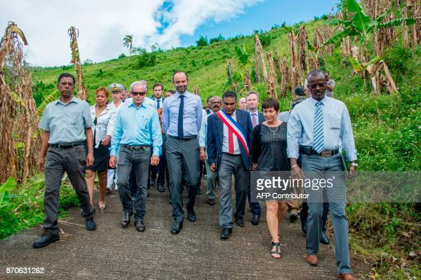 France's Prime Minister Edouard Philippe speaks with Trois Rivieres mayor JeanLouis Francisque and President of the Guadeloupe Banana Association...