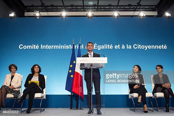 France's Prime Minister Manuel Valls delivers a speech during a visit to the Vigne Blanche district in Les Mureaux on October 26 2015 French Health...