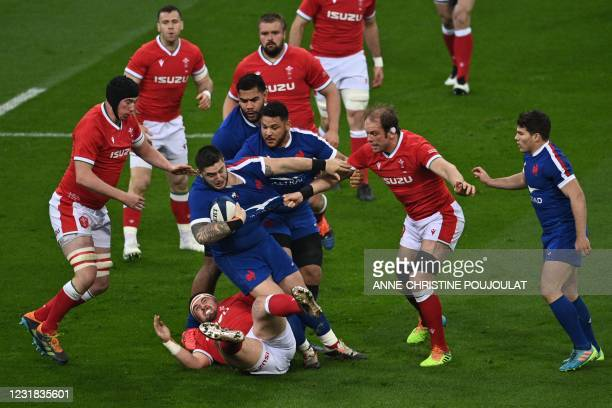France's prop Cyril Baille is tackled by Wales' prop Wyn Jones and Wales' lock Alun Wyn Jones during the Six Nations rugby union tournament match...