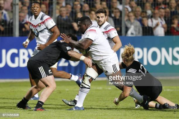 France's prop Demba Bamba runs with the ball during the U20 World Rugby union Championship semifinal match between France and NewZealand at the Aime...