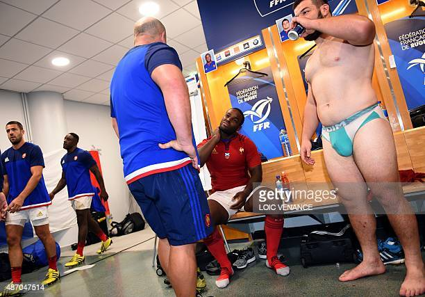 France's prop Eddy Ben Arous sits next to France's prop Nicolas Mas in the locker room after the rugby union test match between France and Scotland...