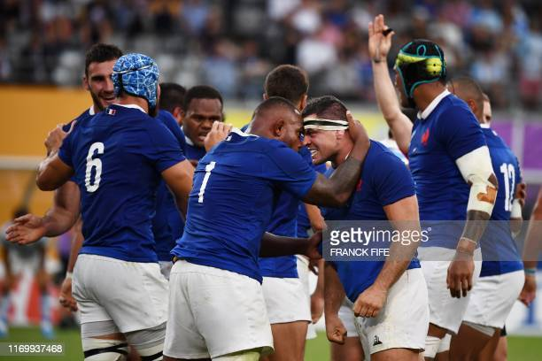France's prop Jefferson Poirot and France's hooker Guilhem Guirado react during the Japan 2019 Rugby World Cup Pool C match between France and...