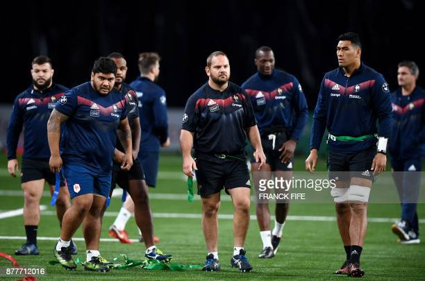 France's prop Sebastien Taofifenua and teammates take part in a training session at the U Arena in Nanterre near Paris on November 23 two days ahead...