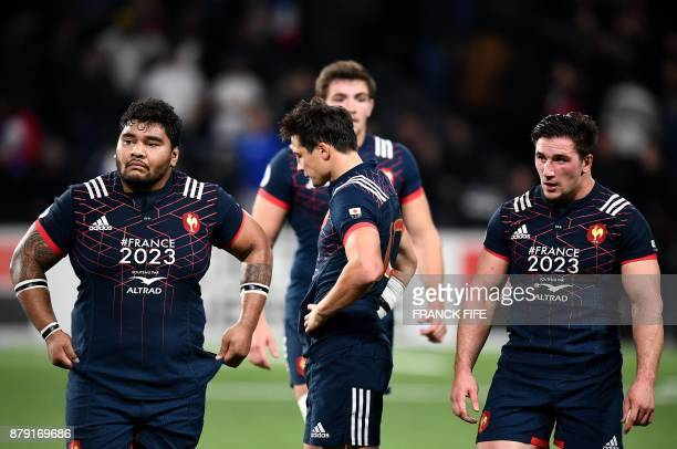TOPSHOT France's prop Sebastien Taofifenua France's fly half Francois Trinh Duc and France's prop Camille Chat react at the end of the rugby union...