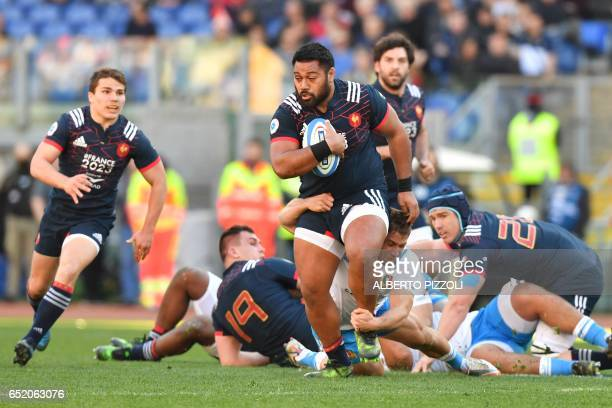France's prop Uini Atonio escapes from a tackle during the International Six Nations rugby union match Italy vs France on March 11, 2017 at the...