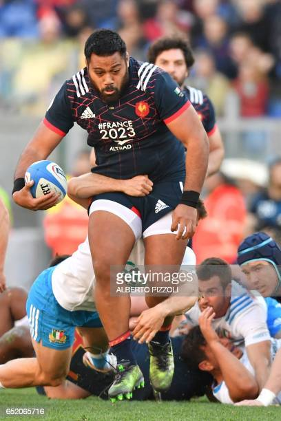 France's prop Uini Atonio tries to escape during the International Six Nations rugby union match Italy vs France on March 11, 2017 at the Olympic...