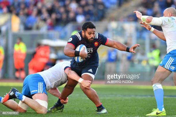 France's prop Uini Atonio tries to escape from a tackle during the International Six Nations rugby union match Italy vs France on March 11, 2017 at...