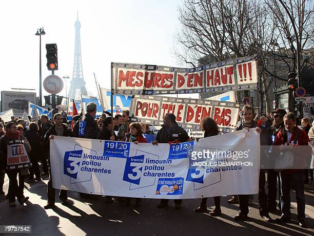 France's public broadcasters employees demonstrate in the street of Paris on February 13 to protest against the announcement by French President...