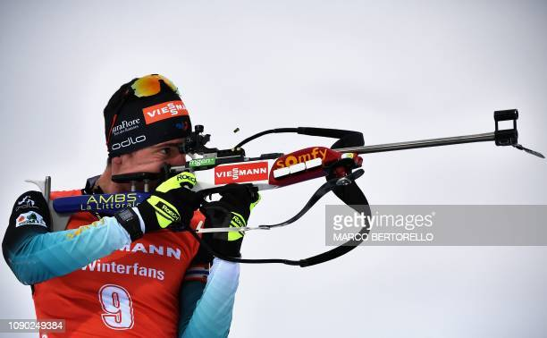 TOPSHOT France's Quentin Fillon Maillet competes at the shooting range on his way to win the men's 15 km mass start event of the IBU Biathlon World...