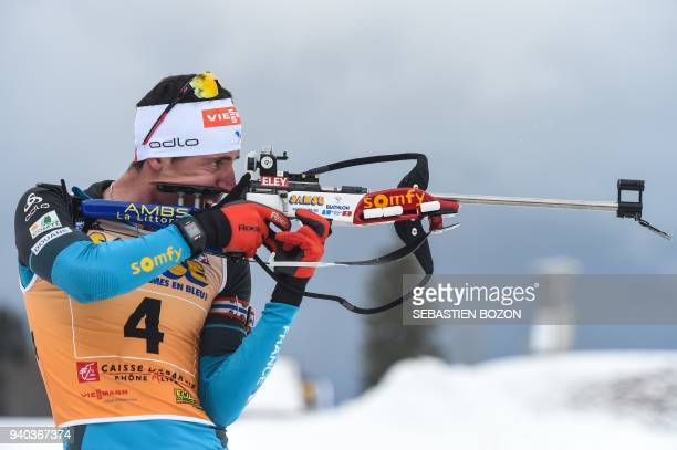 TOPSHOT France's Quentin Fillon Maillet competes during the mass start Premanon French Biathlon Championships on March 31 2018 in Premanon / AFP...