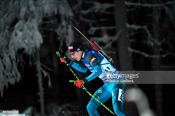 France's Quentin Fillon Maillet competes during the men 20 km individual event at the IBU World Cup Biathlon in Ostersund Sweden on November 30 2017...