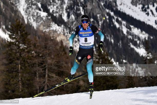 France's Quentin Fillon Maillet competes in the IBU Biathlon World Cup 10 km Men's sprint in Rasen-Antholz , Italian Alps, on February 15, 2020.