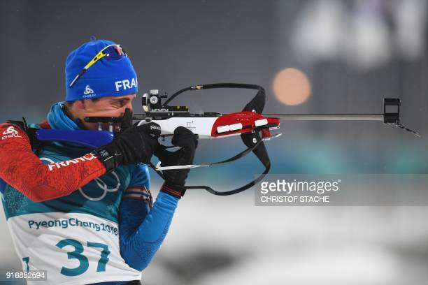 France's Quentin Fillon Maillet warms up prior to the start of the men's 10km sprint biathlon event during the Pyeongchang 2018 Winter Olympic Games...