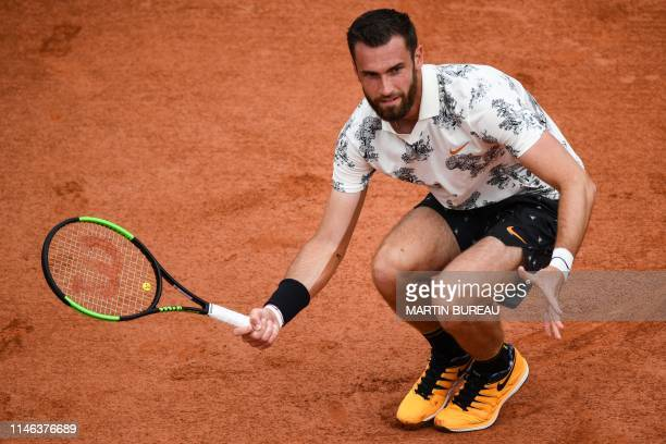 France's Quentin Halys plays a forehand return to Japan's Kei Nishikori during their men's singles first round match on day 1 of The Roland Garros...