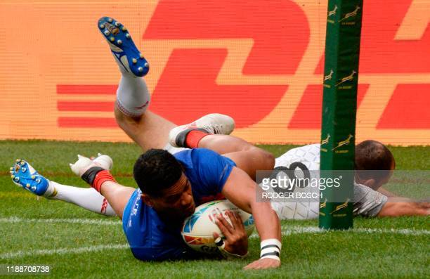 France's Remi Siega scores a try during the Cape Town leg of the World Rugby Sevens Series rugby match between England and France on December 14 2019...