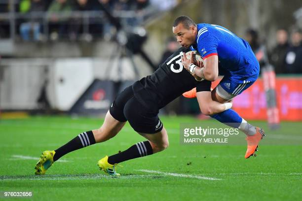 TOPSHOT France's Remy Grosso is tackled by New Zealand's Jordie Barrett during the second rugby Test match between New Zealand and France at Westpac...