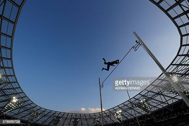 France's Renaud Lavillenie clears the bar during the men's pole vault event at the IAAF Diamond League Anniversary Games athletics meeting at the...