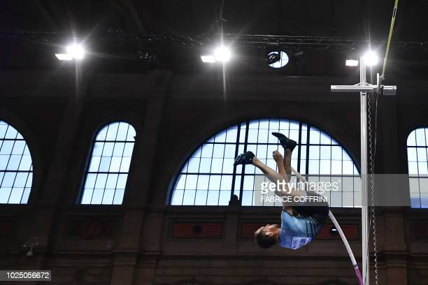 France's Renaud Lavillenie competes in the men's pole vault event inside Zurich's main railway station during the IAAF Diamond League Athletics...