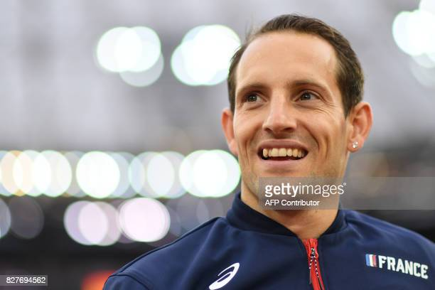 France's Renaud Lavillenie warms up ahead of the final of the men's pole vault athletics event at the 2017 IAAF World Championships at the London...
