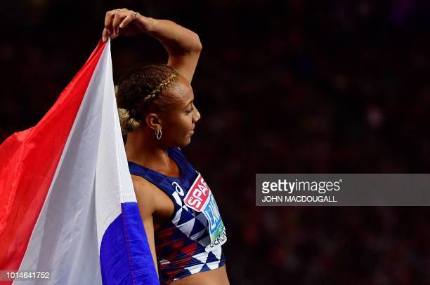 France's Renelle Lamote celebrates after the women's 800m final race during the European Athletics Championships at the Olympic stadium in Berlin on...