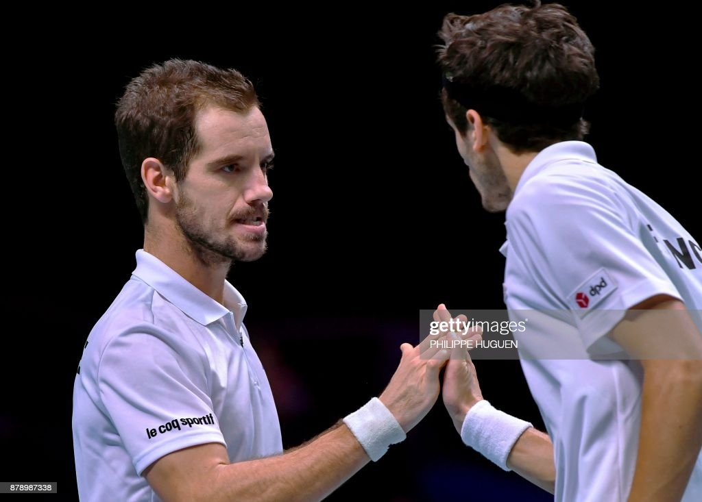 France's Richard Gasquet (L) and France's Pierre-Hugues Herbert react during the doubles tennis match at the Davis Cup World Group final between France and Belgium at Pierre Mauroy Stadium in Lille on November 25, 2017. /