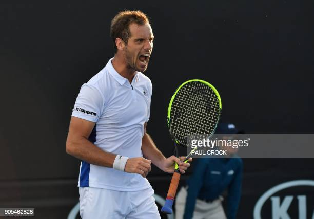 France's Richard Gasquet celebrates after victory over Slovenia's Blaz Kavcic in their men's singles first round match on day two of the Australian...