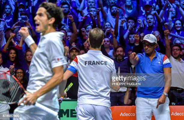 France's Richard Gasquet celebrates with captain Yannick Noah next to France's PierreHugues Herbert during the doubles tennis match at the Davis Cup...