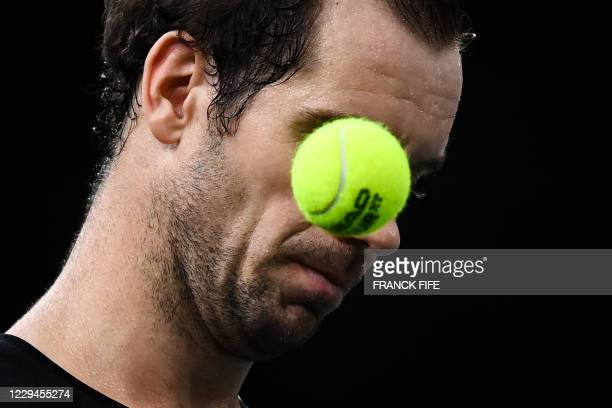 France's Richard Gasquet eyes the ball as he plays against Argentina's Diego Schwartzman during their men's singles second round tennis match on day...