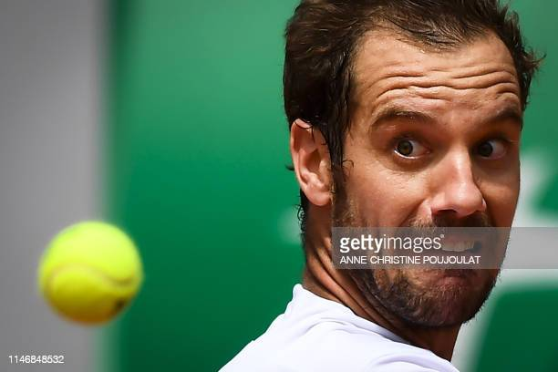 France's Richard Gasquet eyes the ball as he returns the ball to Argentina's Juan Ignacio Londero during their men's singles second round match on...